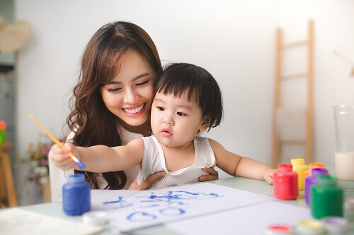 mother painting with child